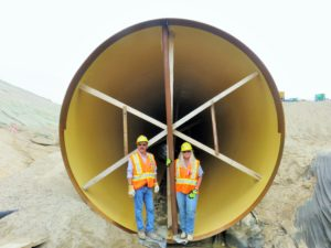 Wayne Ross and Sue Hartwig standing in a piece of the penstock.