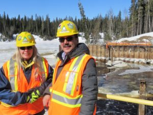 Wayne Ross, CRP President, and Sue Hartwig, CRP First Nations Project Manager, at the Tailrace of the newly completed Peter Sutherland Sr. Generating Station.